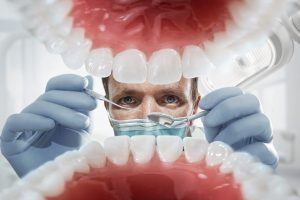 Dentist looking into mouth